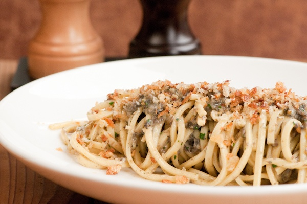 Housemade Chitarra, Wild Burgundy Snail Bolognese, Soft Herbs, and Crunchy Crumb Topping