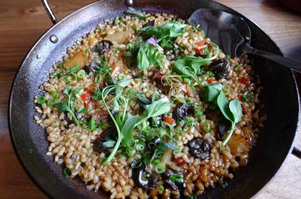 Paella de Conejo y Lumach. Rabbit and Wild Burgundy Snail Paella with Nepitella and Squashes.