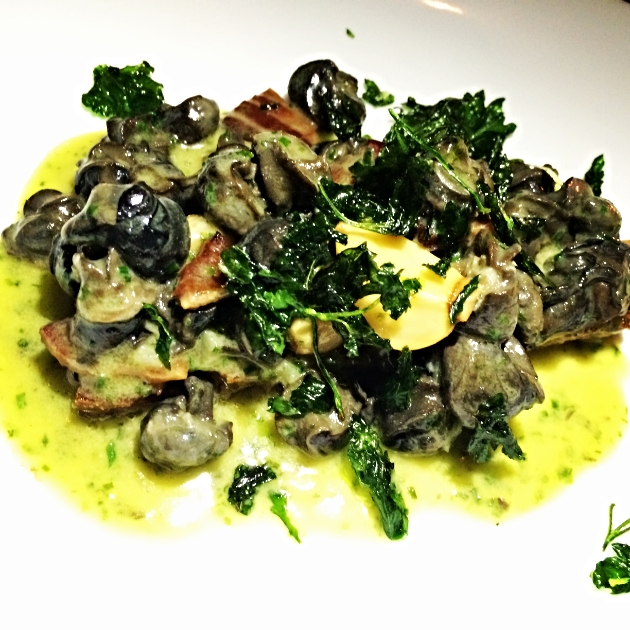 Escargot with Garlic Confit, Benton's Bacon, & Sourdough.